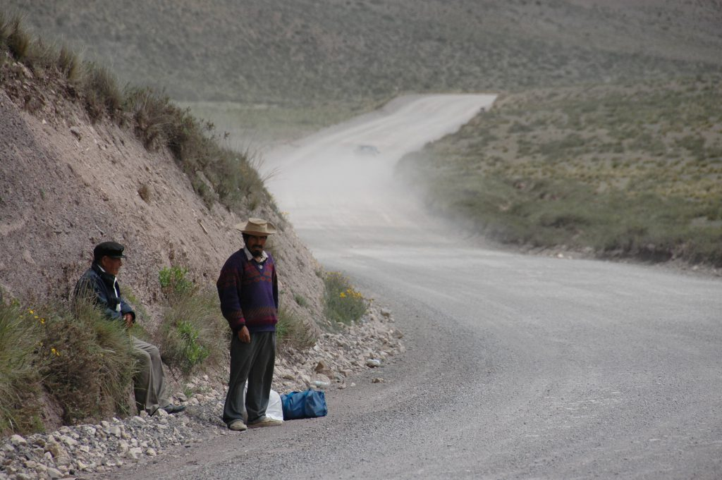 Workers on a lonely road near Salta, Argentina